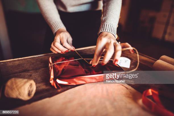 woman making the package for the christmas gift