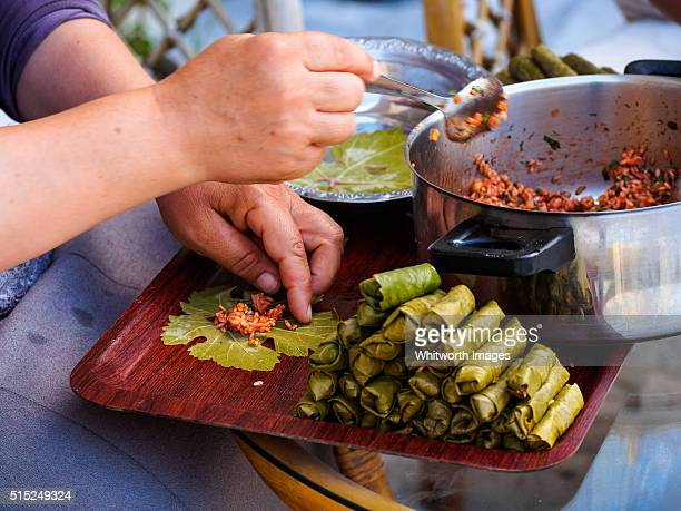 woman making traditional turkish dolmades - dolmades stock pictures, royalty-free photos & images