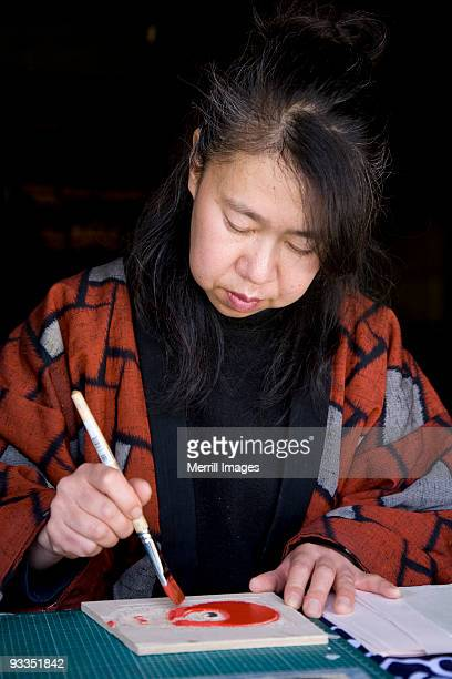 woman making traditional woodcut design on paper  - takayama city stock pictures, royalty-free photos & images