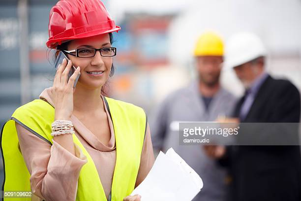 Woman manager talking on the phone at commercial dock
