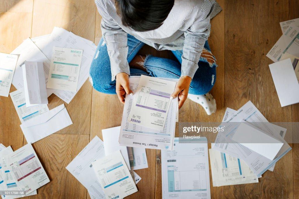 Woman managing the debt : Stock Photo