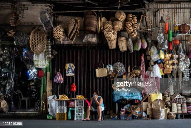 Woman mans a store in Manila, Philippines on August 26, 2020. The Philippines economy shrank by 16.5% in the second quarter amid the pandemic.