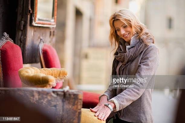 Woman marveling at antique furniture