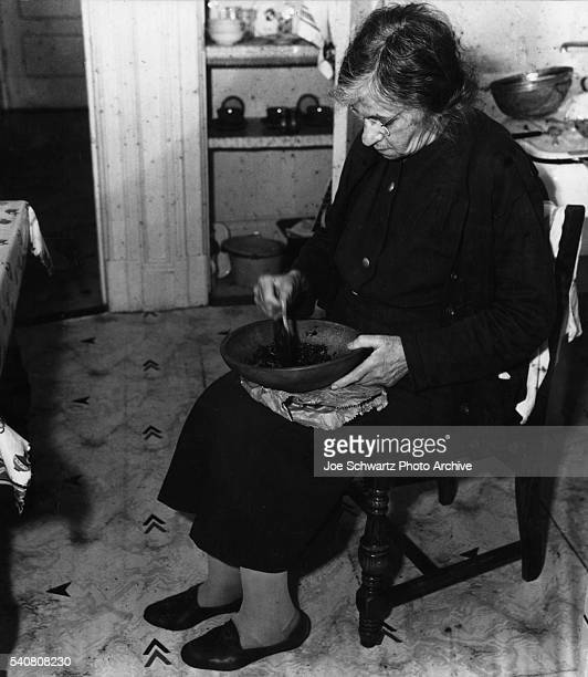 Woman Mashing Food in Bowl