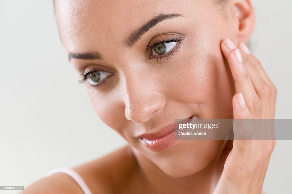 Woman massaging face with finger : Stock Photo