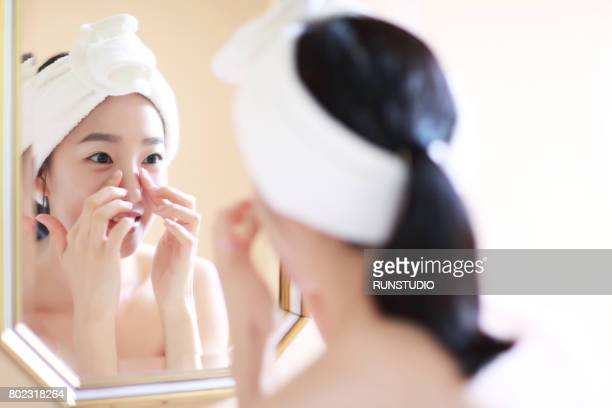 Woman massaging face with finger