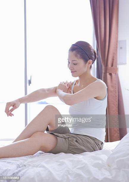 Woman massaging her arms