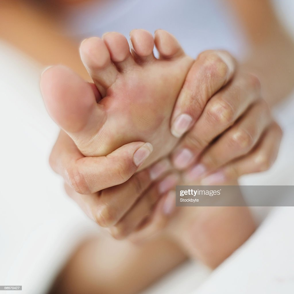 woman massaging her foot : Stock Photo