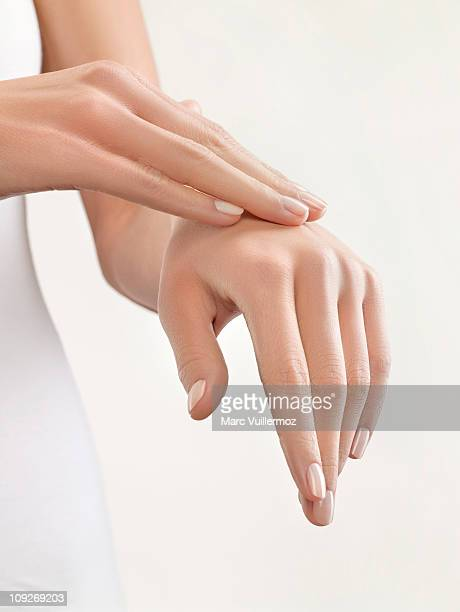 woman massaging her hand, close-up - softness stock pictures, royalty-free photos & images