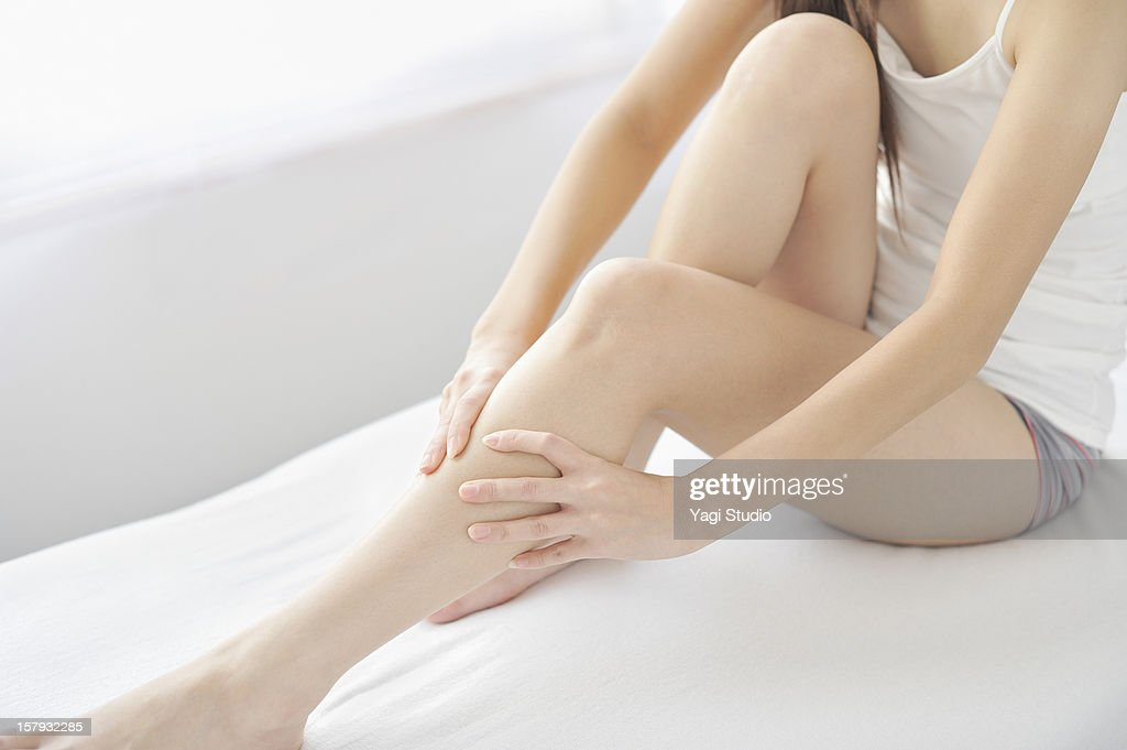 Woman massaging legs : Stock Photo