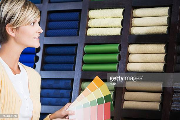 Woman Matching Fabrics with Color Samples