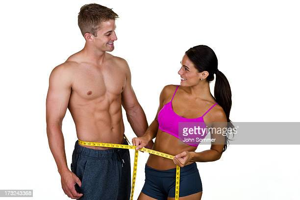 Woman measuring a man's waist