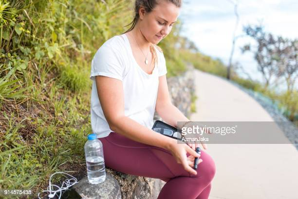 Woman measuring glucose after workout
