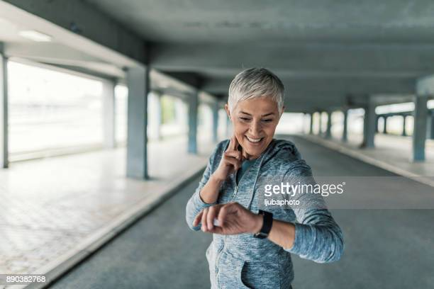 Woman measuring heart rate after running