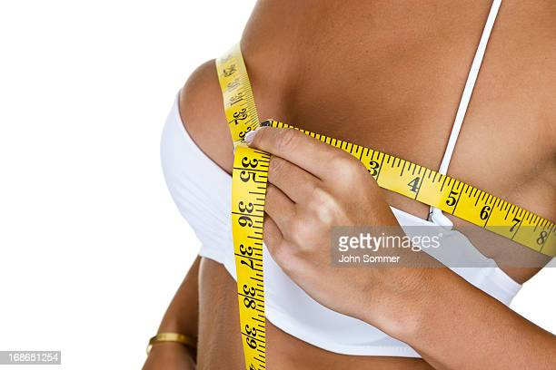 Woman measuring her bust size