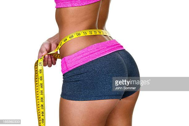 woman measuring her waist - beautiful female bottoms stock photos and pictures