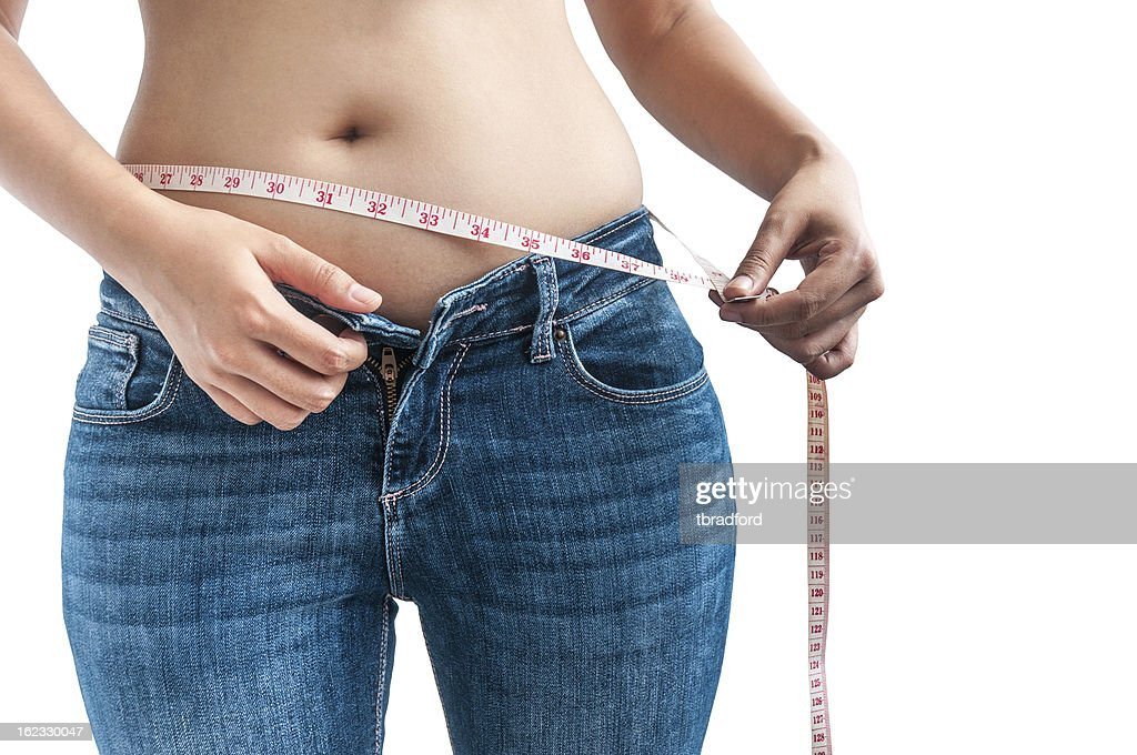 Woman Measuring Her Waist : Stock Photo