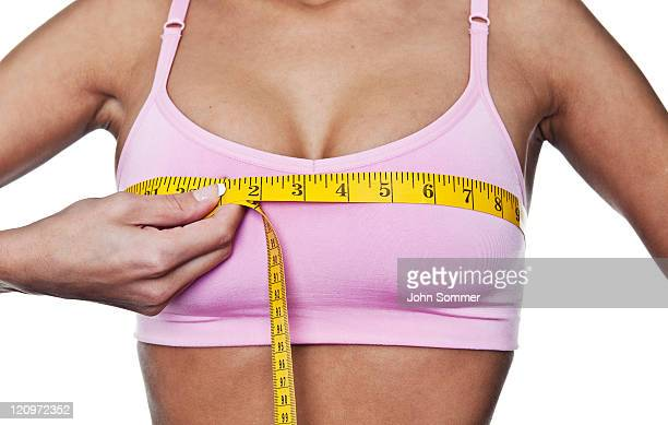 Woman measuring herself