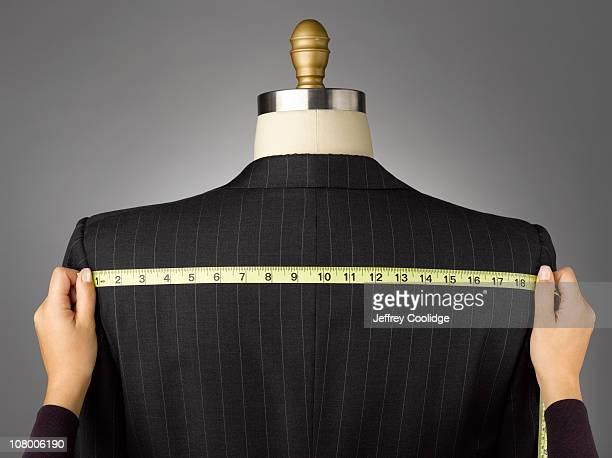 Woman Measuring Jacket on Male Dress Form