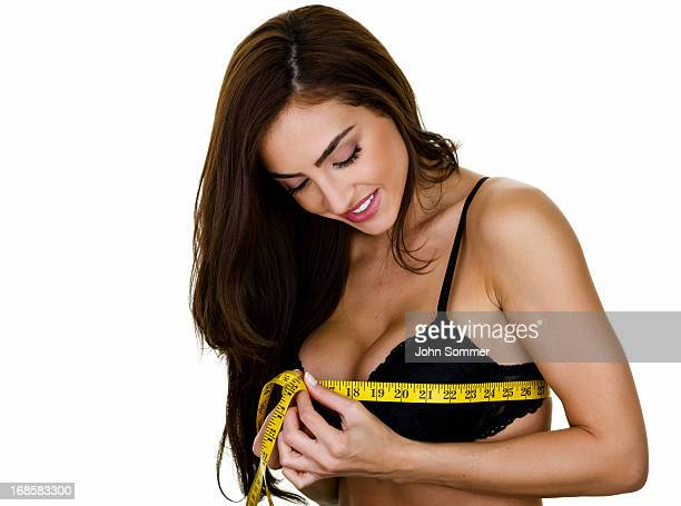 woman measuring - big cleavage stock photos and pictures