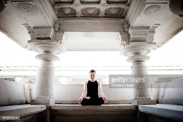 Woman meditating in a temple