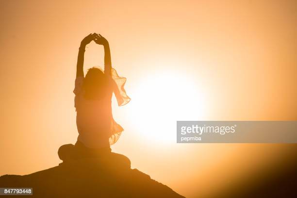 woman meditating in nature - spirituality stock pictures, royalty-free photos & images