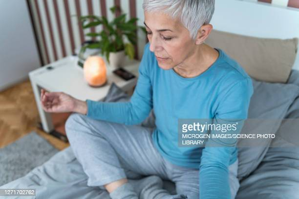 woman meditating - buddhism stock pictures, royalty-free photos & images