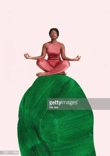 woman meditating sitting crosslegged on hill - hill stock pictures, royalty-free photos & images