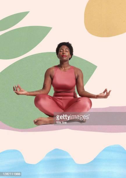woman meditating sitting crosslegged - meditating stock pictures, royalty-free photos & images