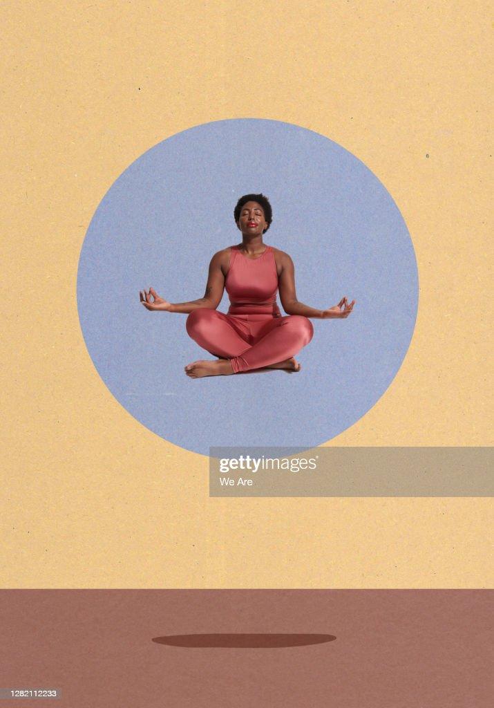 woman meditating sitting crosslegged : Stock Photo