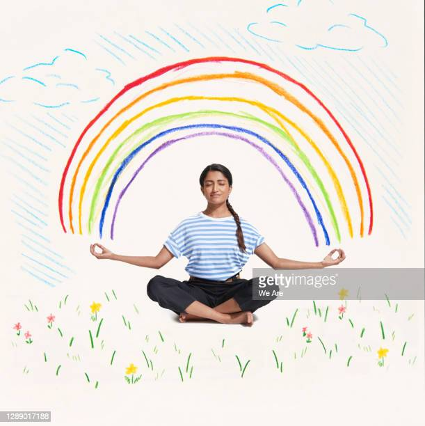 woman meditating with rainbow - limb body part stock pictures, royalty-free photos & images