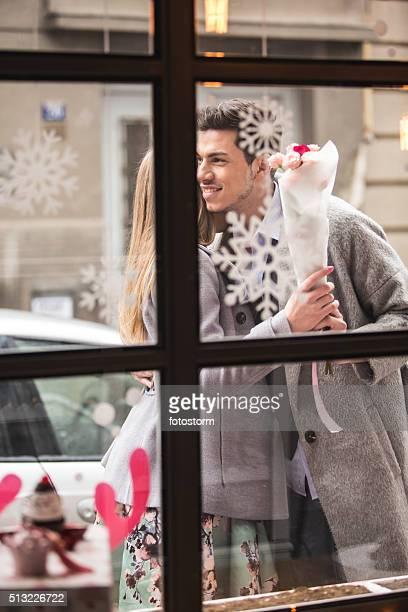 Woman meeting man, receiving flowers