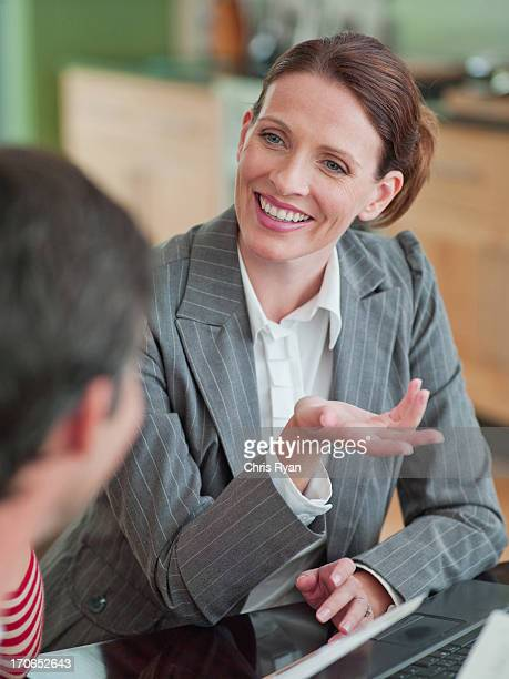 Woman meeting with financial advisor in dining room