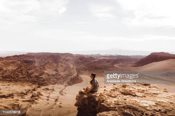 woman meets sunset at beautiful canyon in atacama desert - chile stock pictures, royalty-free photos & images
