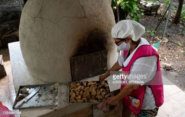 Woman, member of a company of typical food, bakes for tourists in Guanacaste, Costa Rica, on August 24, 2021. - Costa Rica has recovered in the...