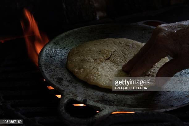 Woman, member of a company of typical food, cooks for tourists in Guanacaste, Costa Rica, on August 24, 2021. - Costa Rica has recovered in the...
