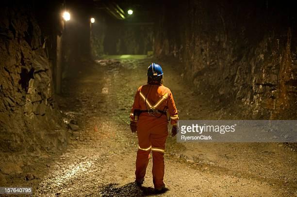 Woman Mine Worker under ground in a tunnel.