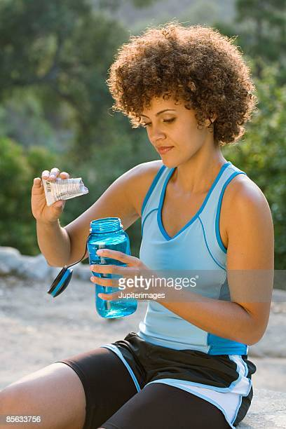 Woman mixing beverage with a drink mix