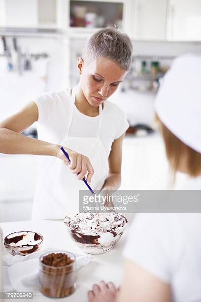 Woman mixing cake mixture in bowl