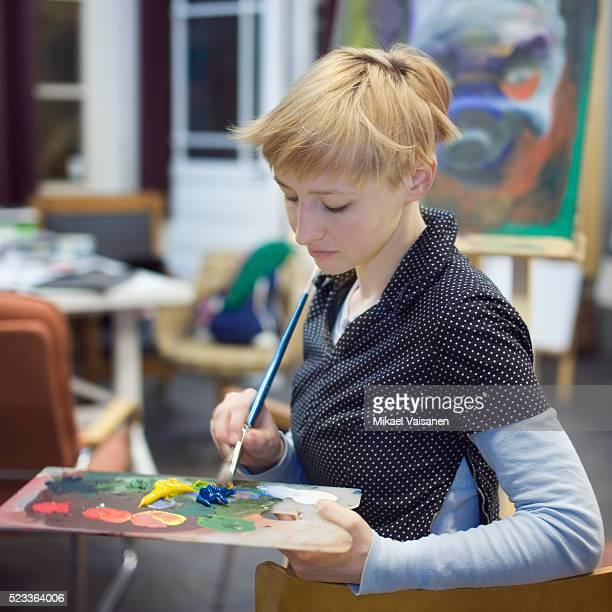 Woman mixing paints