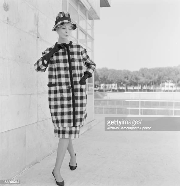A woman modelling a checked winter coat and matching hat Rome circa 1957