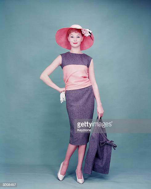 Woman modelling a day dress and sunhat as part of the new Dior collection.