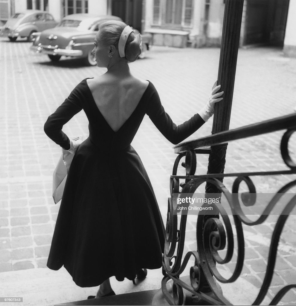 A woman modelling a dress by Lanvin with a plunging back, Paris, September 1954. Original publication: Picture Post - 7264 - Fashion's New Alphabet - pub. 4th September 1954