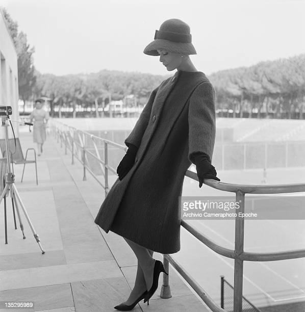 A woman modelling a threequarter length winter coat and matching hat Rome circa 1957