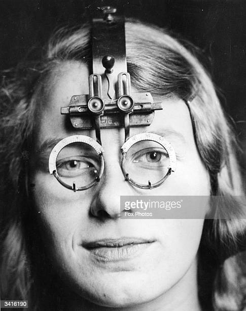 A woman modelling the latest eye test equipment which is lighter and easier to wear than before