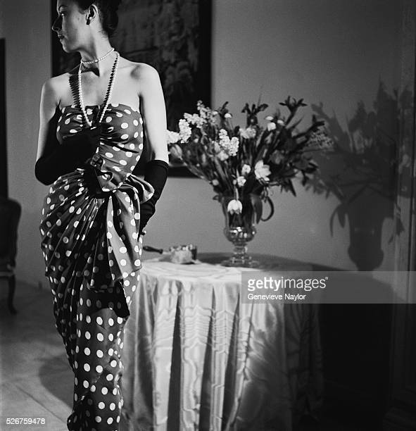 A woman models a polka dot evening dress by Balenciaga