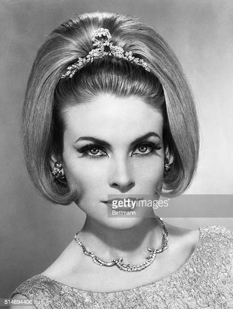 A woman models a princesslike hairstyle designed by coiffure stylist Alexandre of Paris The elegant hairstyle features a demiwig and a diamond diadem...