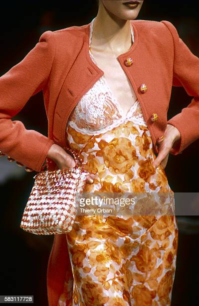 A woman models an outfit from French designer Emanuel Ungaro's haute couture 1997 springsummer fashion show in Paris The fashion model is wearing a...