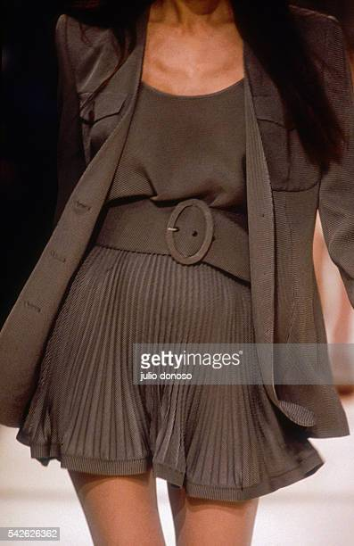 A woman models an outfit from Italian designer Emporio Armani's readytowear collection during the springsummer 1992 fashion show in Milan The fashion...