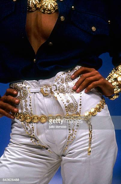 Woman models an outfit from Italian designer Versace's ready-to-wear collection during the spring-summer 1992 fashion show in Milan. The fashion...